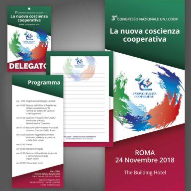 Kit evento per 3° Congresso Nazionale Un.i.coop. 2018: roll up, badge invitati, programma evento, block notes, brochure aziendale